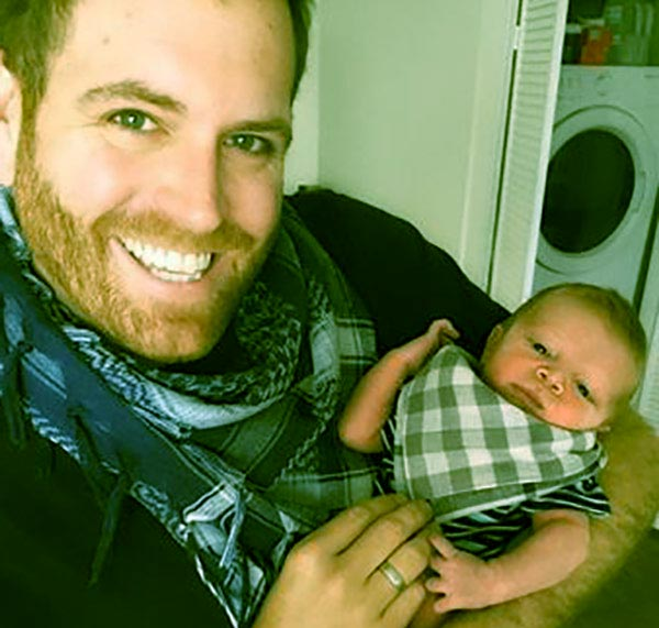 Image of Josh Gates with his son, Owen Gates.