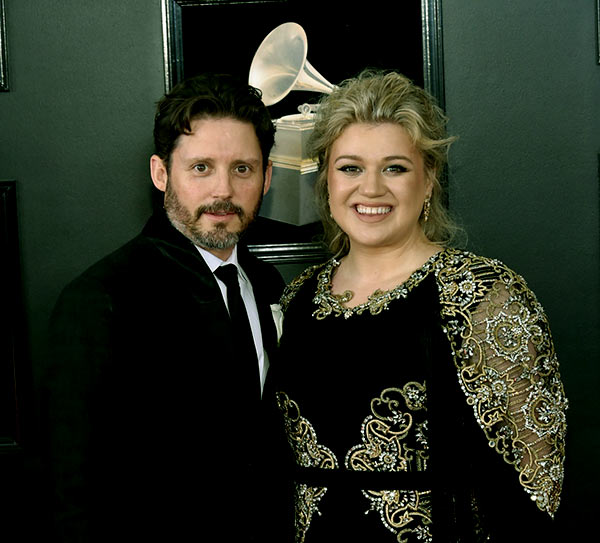 Image of Caption: Brandon Blackstock with his wife Kelly Clarkson