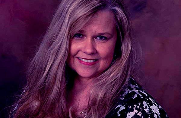 Image of Caption: Debbie Higgins died due to cancer
