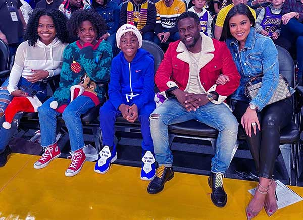 Image of Caption: Eniko Parrish with her husband kevin and with their kids