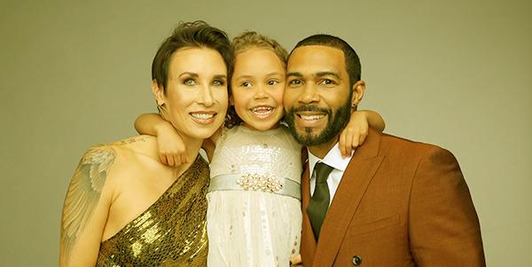 Image of Caption: Jennifer Pfautch with her husband Omari Hardwick and daughter Nova