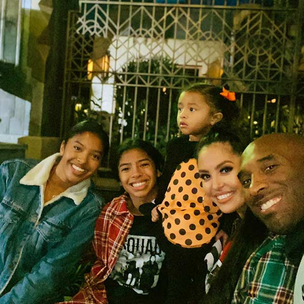 Image of Caption: Venessa and her husband Kobe with their children
