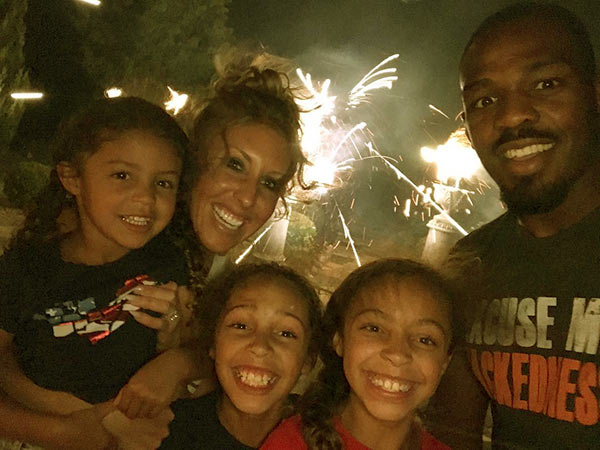 Image of Jessie Moses with her husband Jon Jones and with three beautiful daughters