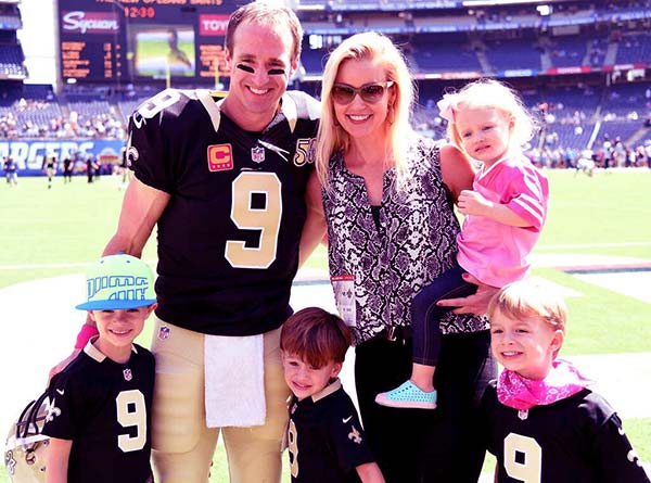 Image of Brittany Brees with her husband and with kids