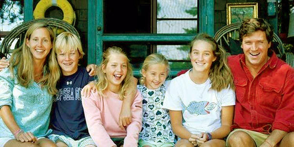 Image of Susan Andrews and her husband, Tucker Carlson with their kids.