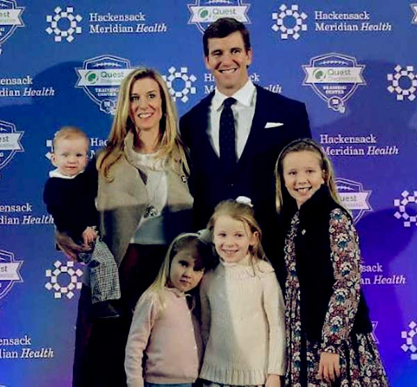 Image of Abby McGrew with her husband along with four kids