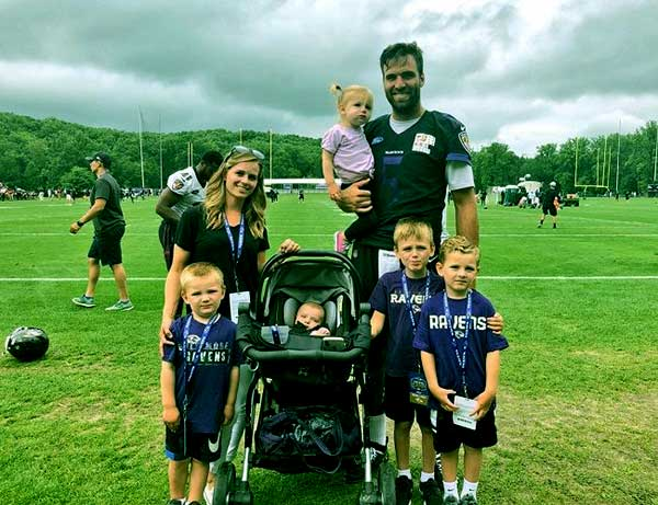 Image of Dana Grady with her husband Joe Flacco along with their kids
